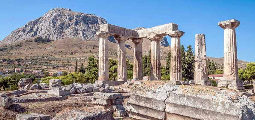 The Temple of Apollo in Ancient Corinth with Acrocorinth in the background