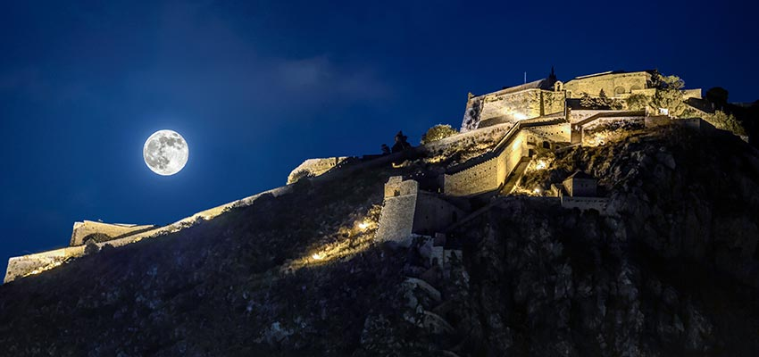 Castle Palamidi lit up at night in Nafplio
