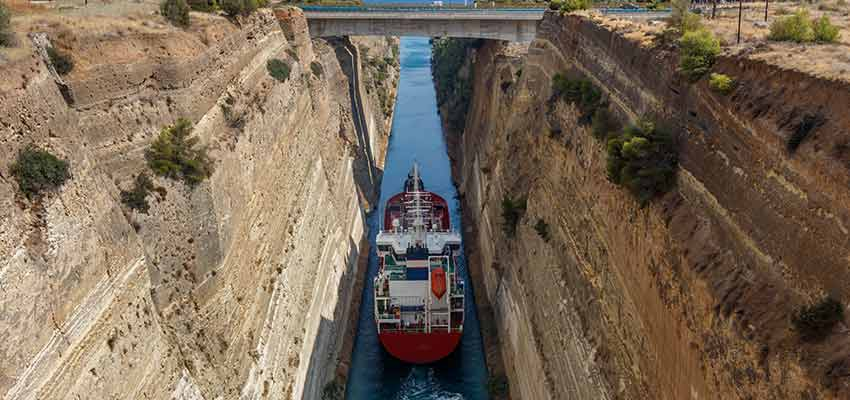A ship sailing through the Corinth Canal