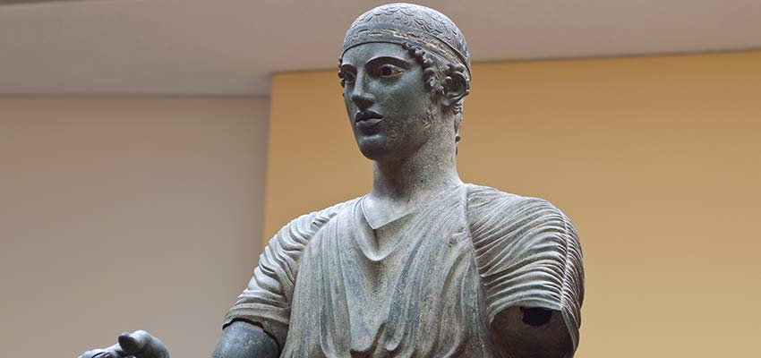 The famous statue of the charioteer at the Delphi museum